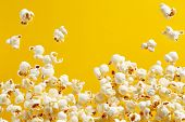 Close-Up Of Popcorn Against Yellow Background poster