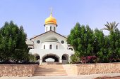 Russian Orthodox Church and The House of a Pilgrims on the site of the baptism of Jesus Christ on t poster