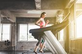 Woman Running On Treadmills Doing Cardio Training In A Gym,healthy Lifestyle Concept poster