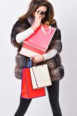 Shopping With Promo Code. Girl Wear Sunglasses And Fur Coat Shopping White Background. Lady Hold Sho poster