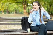 upset businesswoman yelling on mobile phone, outdoor
