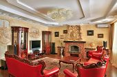 Drawing-room in golden and red colors interior in classic style, expensive furniture