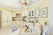 Classic style kitchen and dining room interior in beige pastoral colors