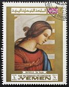 YEMEN - CIRCA 1969: a stamp printed in Yemen shows a picture of the Virgin, painted by Raphael, the famous Italian Renaissance artist. Yemen, circa 1969