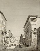 An old print shows a loggia along a street in Palermo, Italy. The original engraving was created by Audot, Lenormand and Ronargue in 1838