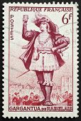 FRANCE - CIRCA 1953: a stamp printed in France shows image of Gargantua, the literary character created by Francois Rabelais. France, circa 1953