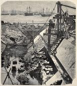 Antique illustration of construction site of a careening dock in Rio de Janeiro. Original, from photo of R. H. Klumb, was published on L'Illustration, Journal Universel, Paris, 1860