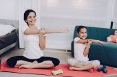 Mother Training With Daughter. Family At Home Training Beautiful Girl At Home. Beautiful Body. Train poster