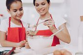 Girl Look How Cook Mother. Young Girl Help Mother With Dough. Young Daughter Preparation Dough. Swee poster