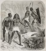 Old illustration of native Africans near Kidi, southern Sudan. Created by Castelli, published on Le