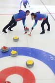 Curling, Team Playing On The Ice. Curling. Players Play Curling On The Curling Track. poster