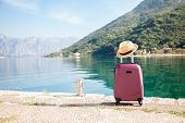 Pink Suitcase With Straw Hat On Sea Beach. Concept Of Travel, Vacation, Female Tourism, Trip, Journe poster