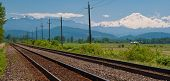 Pacific Canadian Railway and gorgeous view of Mount Baker from Abbotsford, British Columbia, Canada.