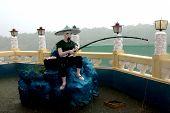 Fisher Man Statue Taoist Temple Cebu In Philippines