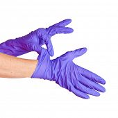 Nurse putting on medical glove isolated on white.