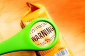 Magnifying Glass On Food Additives Label With Word Warning. Concept Warning Food Additives. Reading  poster