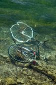 Bicycle drown in water of lake of Zurich