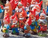 stock photo of dwarf  - Crowd of colorful dwarf figures - JPG