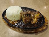 Hot Sizzling Black Paper Lamb With Rice poster