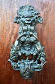 Old metal door handle knocker