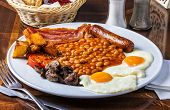 A Full English Breakfast Is A Breakfast Meal That Typically Includes Bacon, Sausages, Eggs, Tomato,  poster