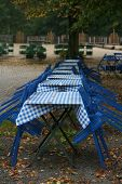 Tables And Chairs In An Autumnal Beer Garden