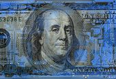 conceptual image of a dollar bill on  circuitboard background