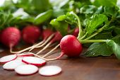 Radishes On A Brown Surface