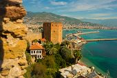 Kizil Kule Tower. Landscape With Marina And Red Tower In Alanya Peninsula, Antalya District, Turkey poster