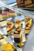 stock photo of bakeshop  - Cake and pastry in window display canteen food dessert tasty - JPG