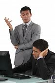 stock photo of disapproval  - Arrogant businessman talking to his colleague - JPG