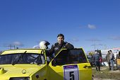 Pilot Nurali against his sports car