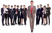 successful business team with a business man walking forward leading it - be different concept - iso