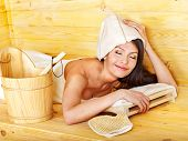 Young woman in hat relax sauna. Weight loss.