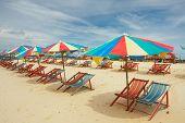 Happy Parasols On Empty Beach