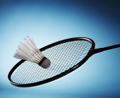 Badminton racket striking shuttlecock