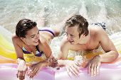 couple having fun on a lilo