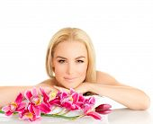 Portrait of pretty woman enjoying dayspa, picture of young beautiful lady with pink orchid flower isolated on white background, zen balance, beauty treatment, luxury spa ralaxation poster