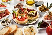 Table full of mediterranean appetizers, tapas or antipasto