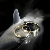 Golden Wedding Rings And Smoke