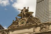 stock photo of poseidon  - These are the statues of Poseidon Athena and Mercury above the entrance of Grand Central Manhattan New York - JPG