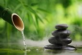 stock photo of fountain grass  - Spa still life with bamboo fountain and zen stone - JPG