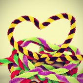 a pile of hearts of different colors made with pipe cleaners, with a retro effect