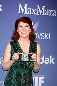 LOS ANGELES - JUN 12:  Kate Flannery arrives at the Crystal and Lucy Awards 2013 at the Beverly Hilt