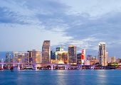 foto of highrises  - CIty of Miami Florida summer sunset panorama with colorful illuminated business and residential buildings and bridge on Biscayne Bay - JPG