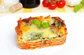 stock photo of lasagna  - fresh vegetarian lasagna with mixed vegetables and basil on top - JPG