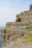Tourists in Dun Aengus, an ancient fort on Inishmore, Aran Islands, Ireland
