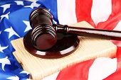 Judge gavel and books on american flag background