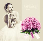 Sitting beauty bride in white dress with shoes in her hands and pink roses wedding bouquet