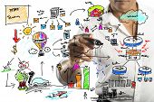 stock photo of enterprise  - A businessman drawing a new business project - JPG